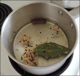 The pickling liquid simmering on the stove.